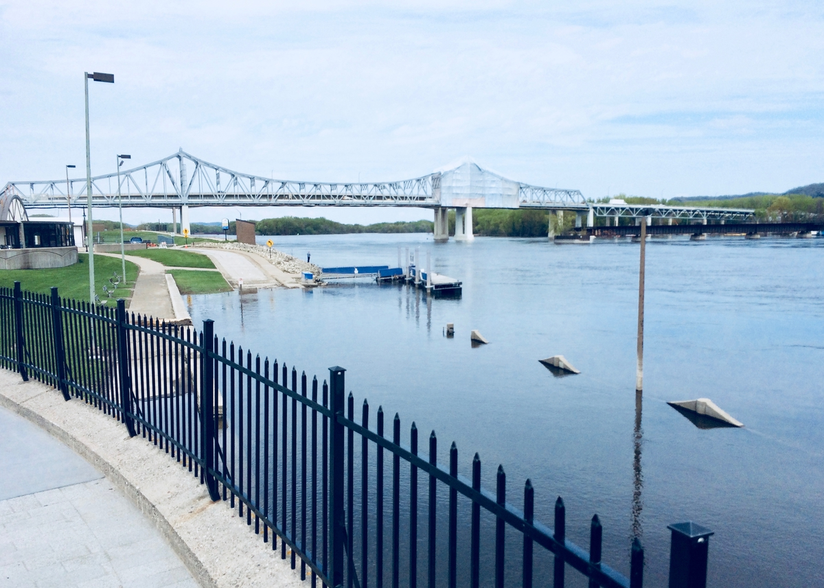 a view of the Mississippi from Levee Park, looking north, when the river has partially flooded the parkway in front of the levee