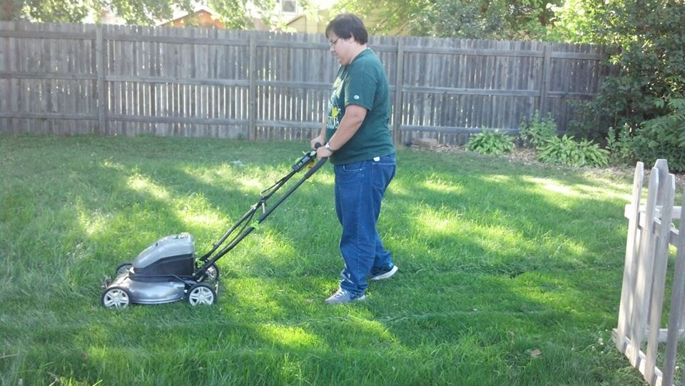 Chris mowing the lawn