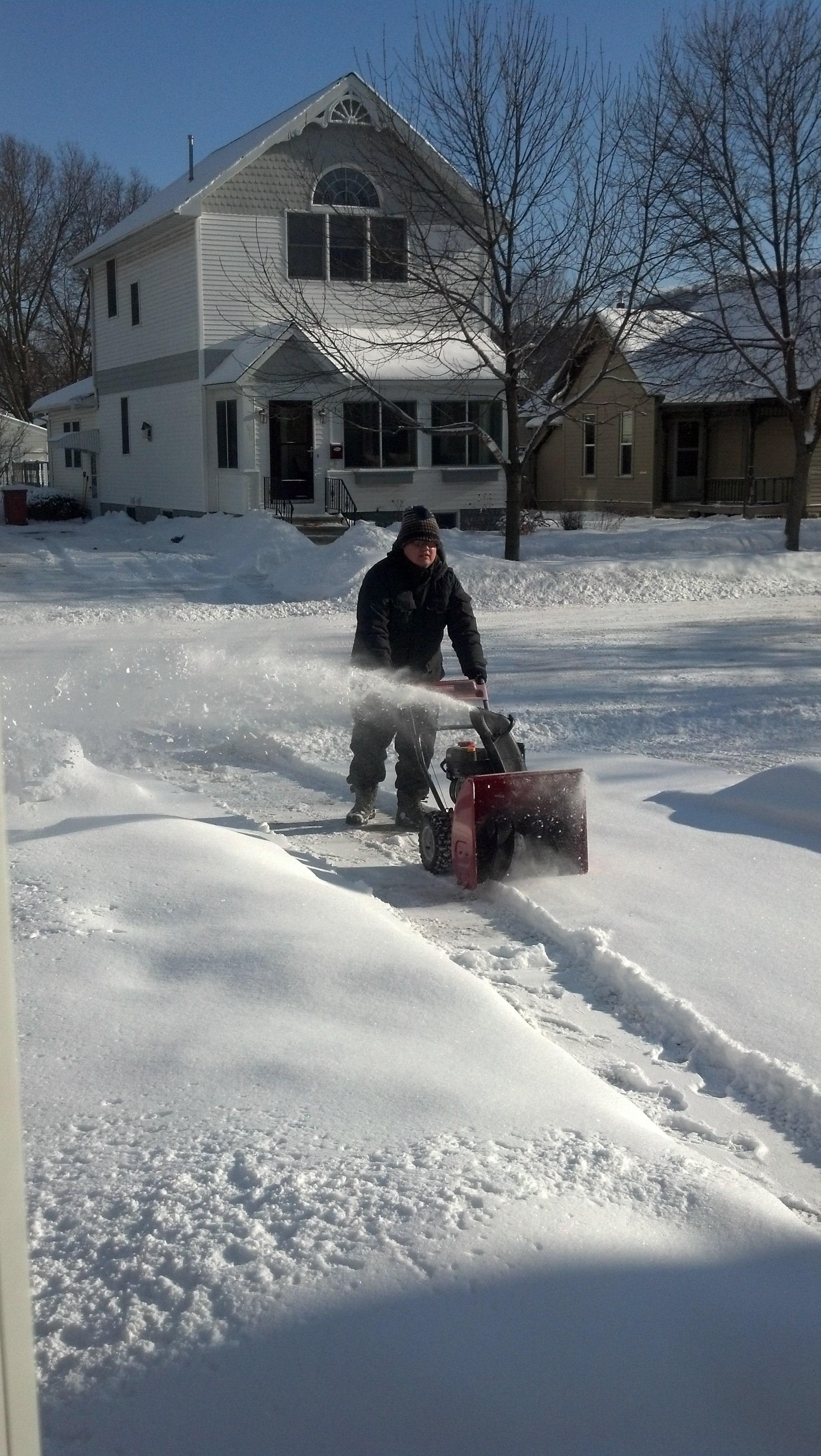Pushing snowblower